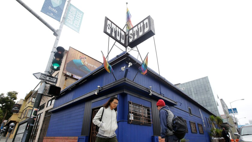 Pedestrians walk in front of The Stud bar in San Francisco on Wednesday.
