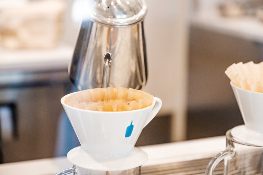 Start the day with a pour-over coffee at Blue Bottle Coffee Co. at One Paseo.