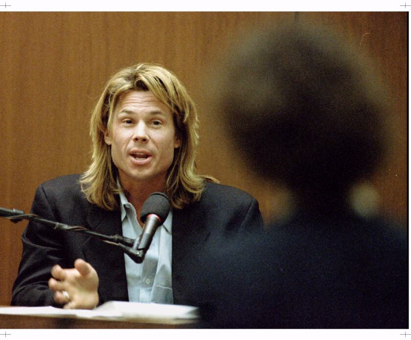 Kato Kaelin responds to questions by prosecutor Marcia Clark during the O.J. Simpson double murder trial.