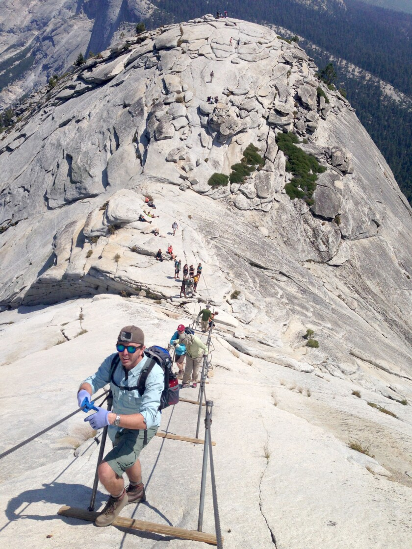 YOSEMITE NATIONAL PARK, CA AUGUST 11, 2015 -- Hikers make their way up the Half Dome Cables August