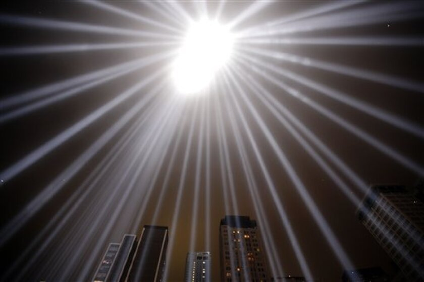 The Tribute in Light shines above Lower Manhattan, marking the 10th anniversary of the attacks at the World Trade Center site, Sunday, Sept. 11, 2011, in New York. (AP Photo/Matt Rourke)