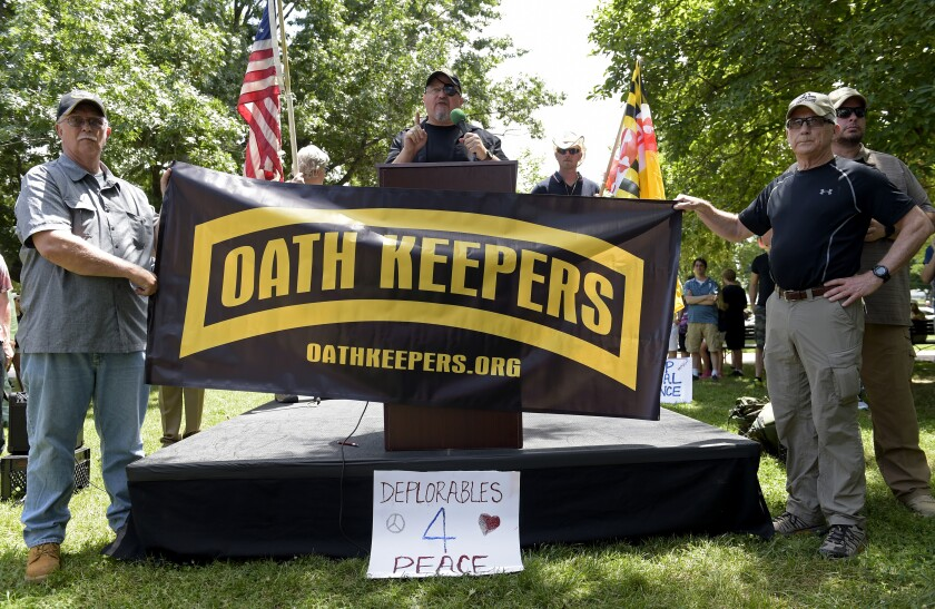 Oath Keepers founder Stewart Rhodes, center, speaks during a rally outside the White House in 2017.