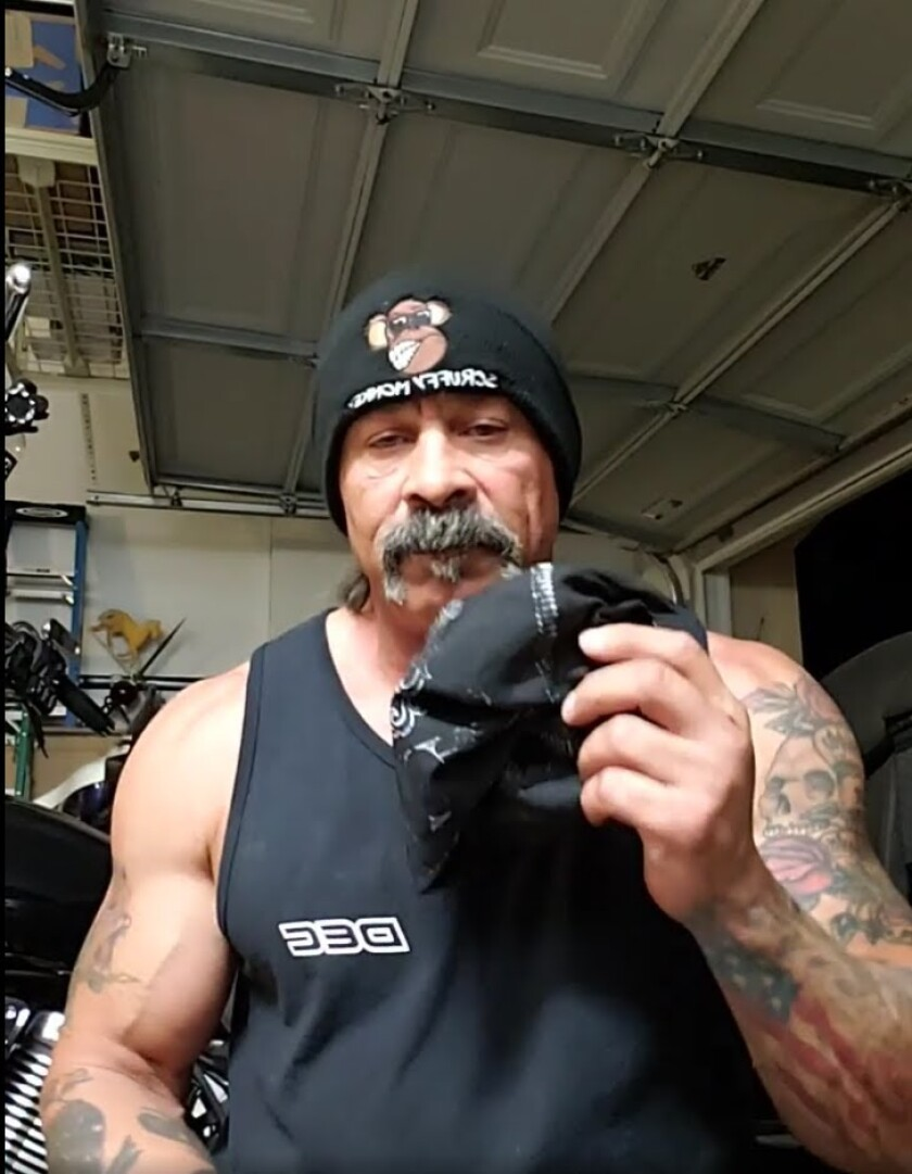 In a video shared on Facebook Sept. 26, Mick Sobczak displays the skull cap of a protester he says he assaulted.