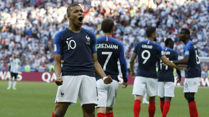 FILE - In this Saturday, June 30, 2018 file photo, France's Kylian Mbappe celebrates after scoring h