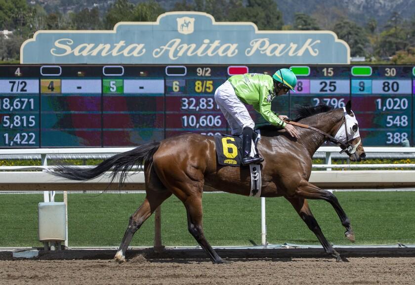 Jockey Aaron Gryder rides Discrete Stevie B to victory at Santa Anita.
