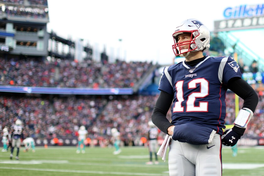 New England Patriots quarterback Tom Brady looks on during the game against the Miami Dolphins  at on Dec. 29, 2019 in Foxborough, Mass.