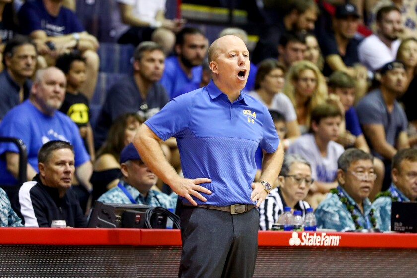 UCLA men's basketball coach Mick Cronin directs his players during a game against Chaminade in Hawaii on Nov. 26.