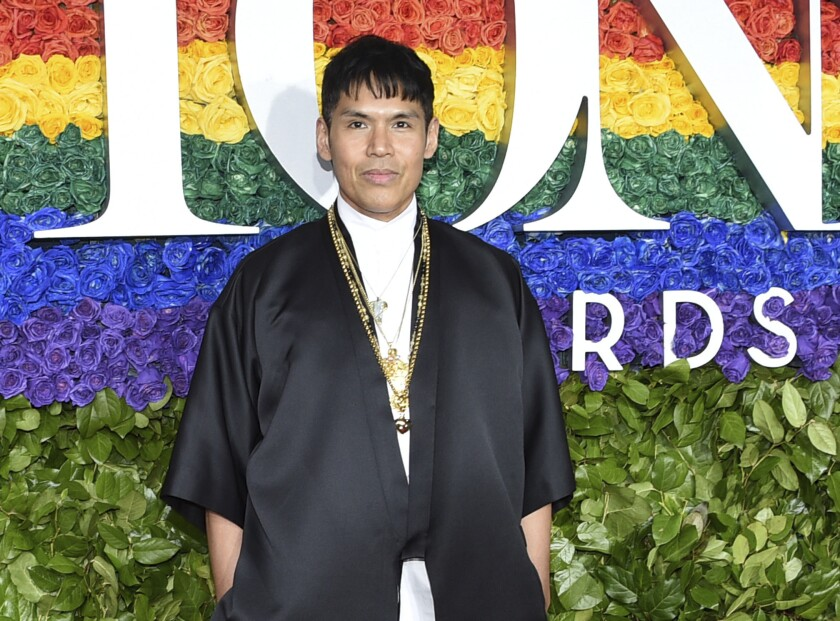 """FILE - Set designer Clint Ramos arrives at the 73rd annual Tony Awards in New York on June 9, 2019. For his striking scenic design in """"Slave Play,"""" Ramos is nominated for two Tony Awards, one for scenic design for """"Slave Play,"""" and one for best costume design for """"The Rose Tattoo."""" (Photo by Evan Agostini/Invision/AP, File)"""