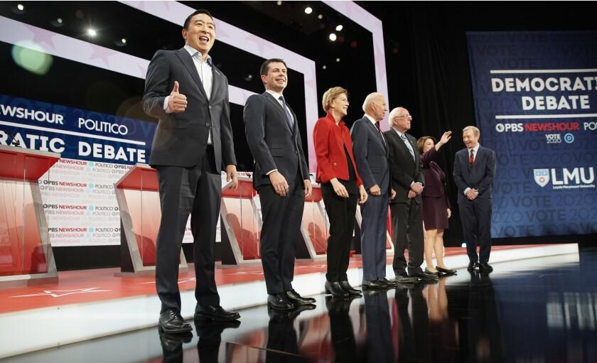 Democratic presidential hopefuls Andrew Yang, left, Pete Buttigieg, Elizabeth Warren, Joe Biden, Bernie Sanders, Amy Klobuchar and Tom Steyer at the December debate. All seven will appear at Friday's debate in Manchester, N.H.