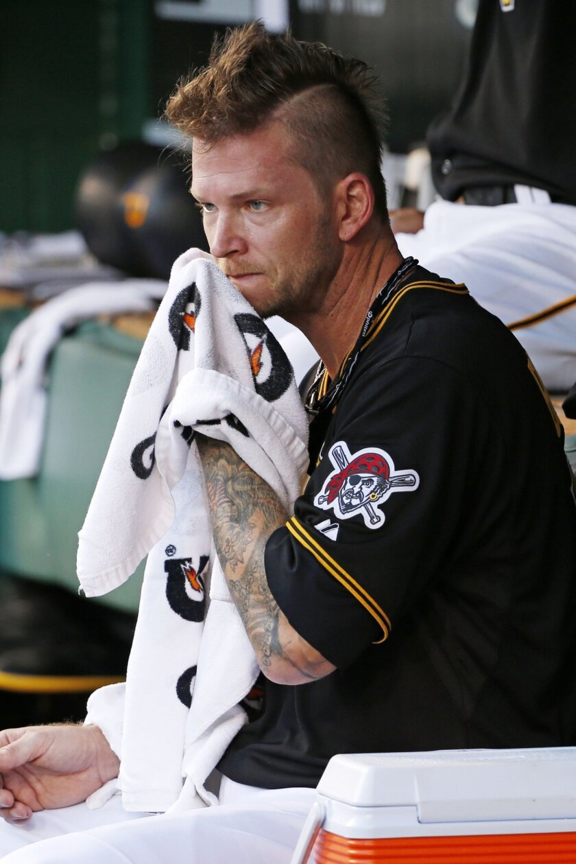 Pittsburgh Pirates starting pitcher A.J. Burnett wipes his face in the dugout during the third inning of a baseball game against the Washington Nationals in Pittsburgh, Saturday, July 25, 2015. (AP Photo/Gene J. Puskar)