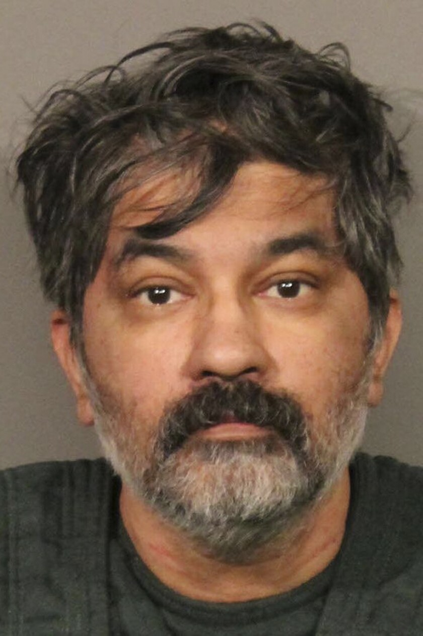 This photo released Tuesday, Oct. 15, 2019, by the Roseville, Calif., Police Department, shows Shankar Hangud, who police in Northern California have identified as the suspect who they say showed up at a police station with a dead body in his car and confessed to killing that person and another three members of a family. Roseville Police Capt. Josh Simon said Tuesday, Oct. 15, 2019, that the 53-year-old Hangud was arrested Monday after he turned himself in to Mount Shasta police and told investigators he had killed the man in his car. (Roseville Police Department via AP)