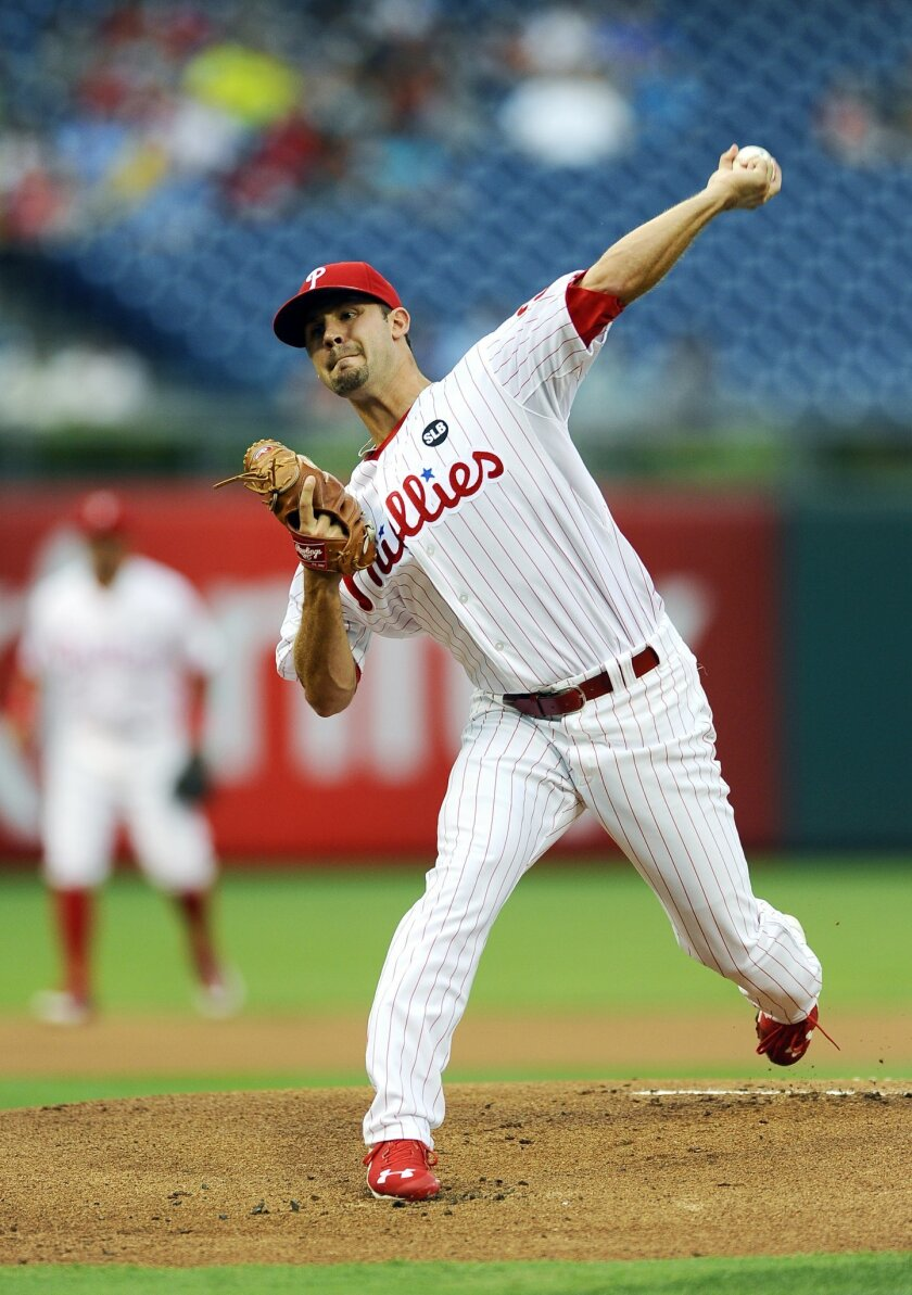Philadelphia Phillies starting pitcher Adam Morgan throws in the first inning of a baseball game against the Miami Marlins, Friday, July 17, 2015, in Philadelphia. (AP Photo/Michael Perez)