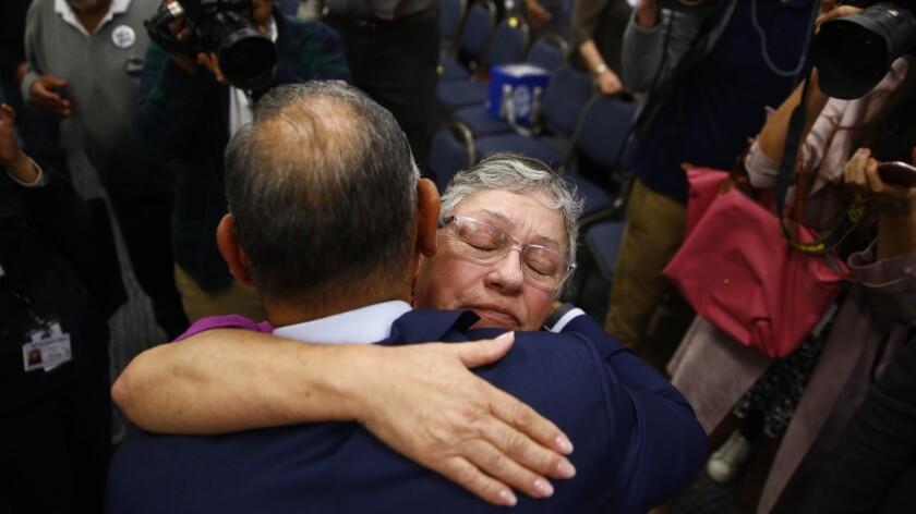 BUENA PARK, CALIF. - NOVEMBER 19: Congressman-elect Gil Cisneros (D-CA39) gets a hug from his mother