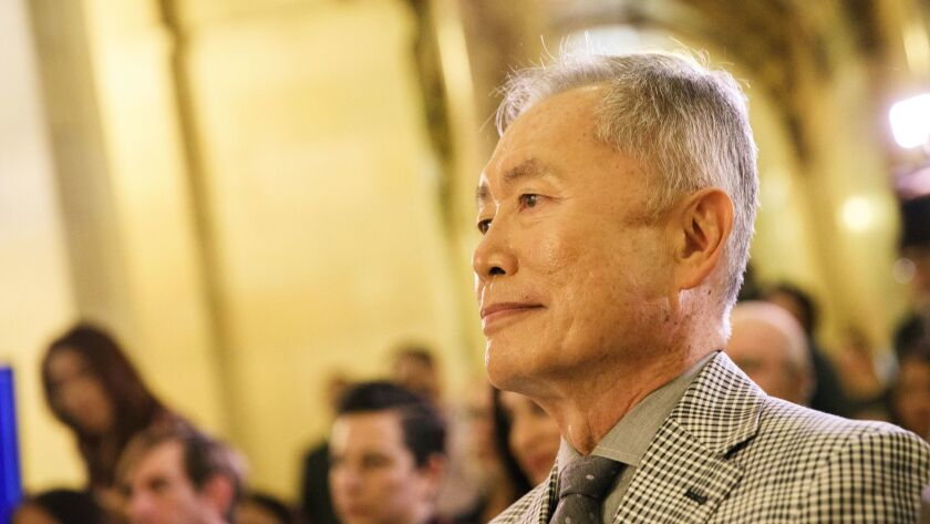 Actor and activist George Takei listens before presenting more than 300,000 Care2 signatures in supp