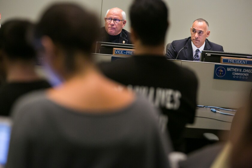 Police Commissioner Steve Soboroff, left, and Police Commission President Matthew Johnson at a commission meeting.