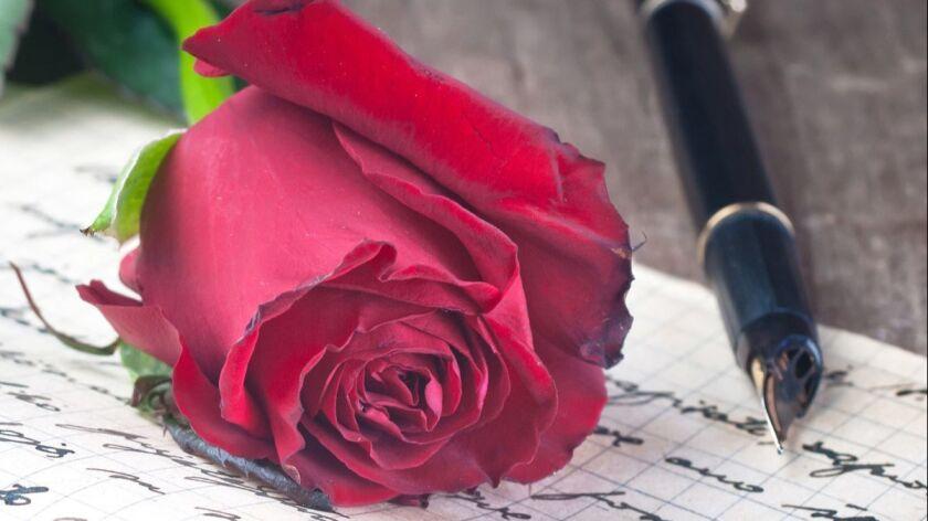 Love letter and rose close up User Upload Caption: .