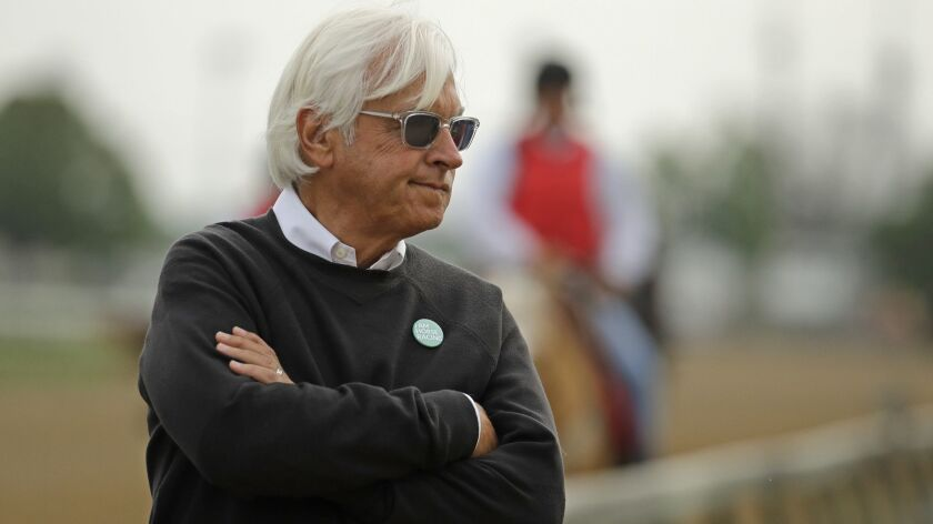 Trainer Bob Baffert watches Game Winner, one of his three Kentucky Derby horses, during a workout May 1 at Churchill Downs.