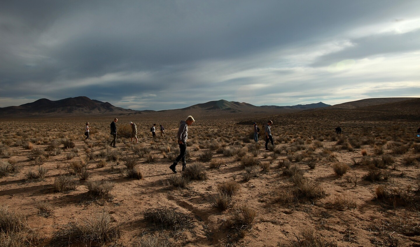 Tourists scour the Mojave Desert landscape on the lookout for debris from a 1967 X-15 crash near Johannesburg.