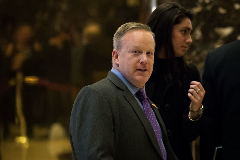Republican National Committee communications director Sean Spicer walks through the lobby at Trump Tower, December 14, 2016 in New York City.