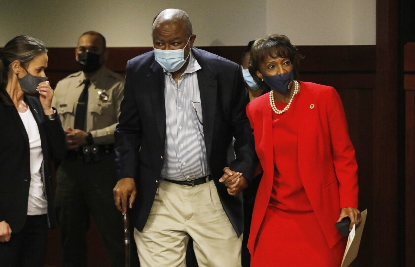 Jackie and David Lacey wear masks and walk hand in hand