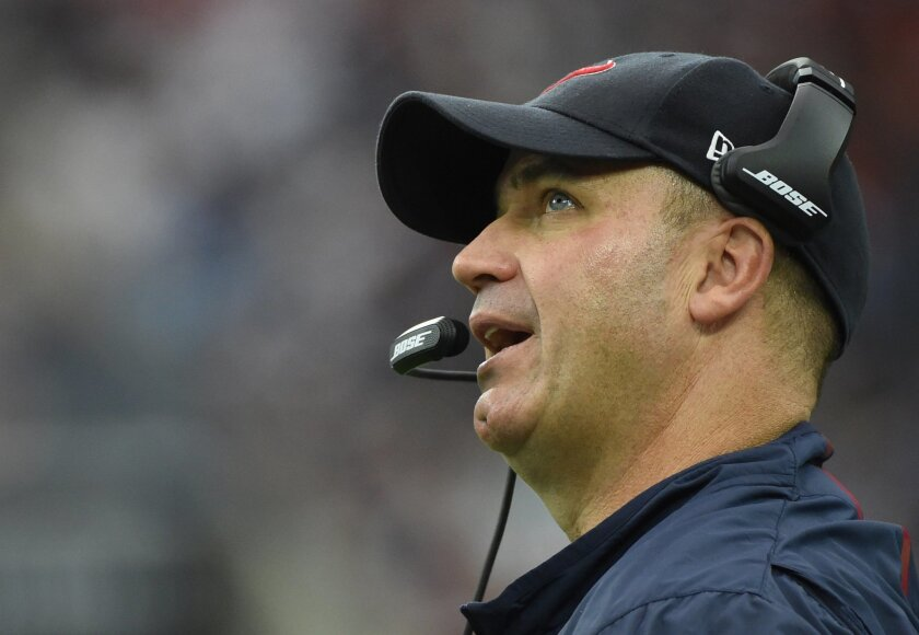 FILE - In this Nov. 1, 2015, file photo, Houston Texans head coach Bill O'Brien is shown during the first half of an NFL football game against the Tennessee Titans, in Houston. With 21 teams not owning winning records through eight weeks, it's no wonder coaches from coast to coast are on the firing