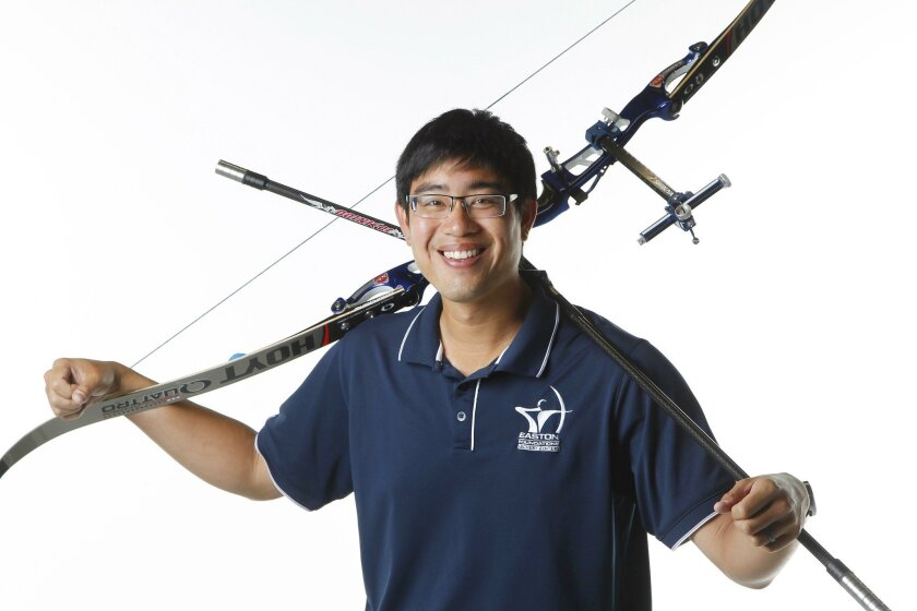 Keaton Chia with his archery bow.