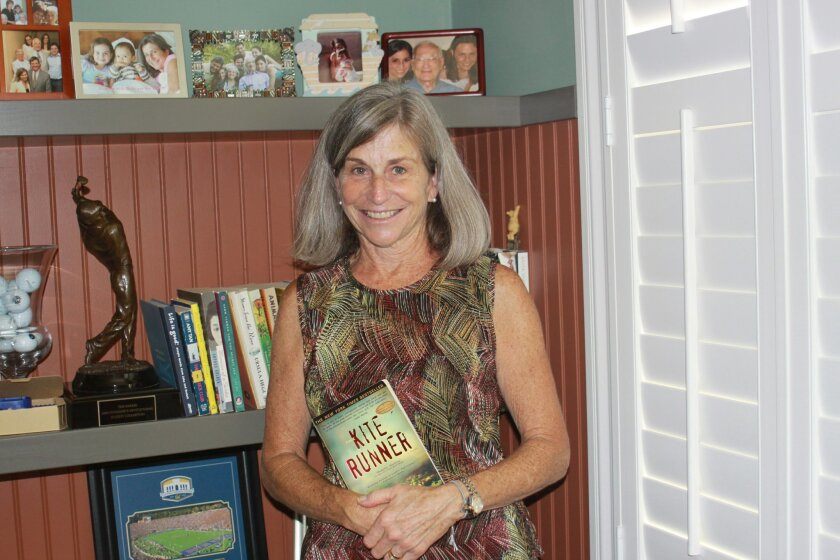 Connie Unger at home in Carmel Valley with her own book collection.