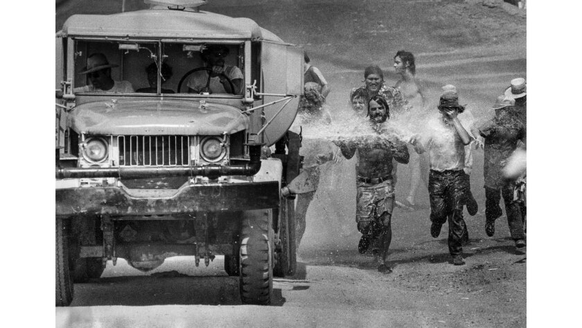 Sept. 7, 1975: When the water truck went out to wet the dust on the track at Riverside International Raceway, a crowd of spectators chased after the truck to cool off in its spray.