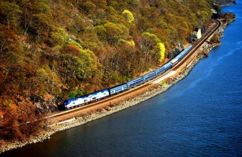 The Lake Shore Limited follows the curves of the Hudson River near Bear Mountain, N.Y., offering passengers spectacular spring views.