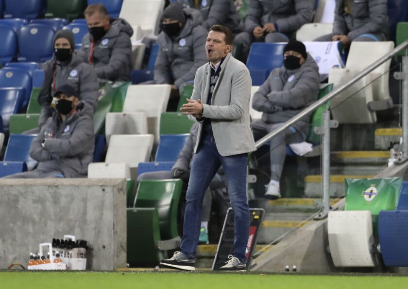 Slovakia's manager Stefan Tarkovic reacts during the Euro 2020 playoff semifinal soccer match between Northern Ireland and Slovakia at Windsor Park, Belfast, Northern Ireland, Thursday, Nov. 12, 2020. (AP Photo/Peter Morrison)