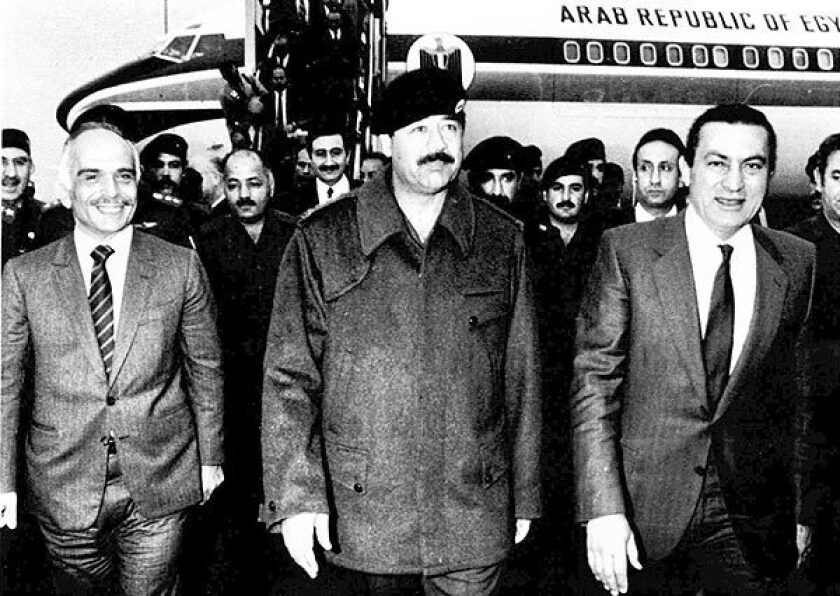 Iraqi President Saddam Hussein welcomes Egyptian President Hosni Mubarak, right, and Jordan's King Hussein to Baghdad on March 19, 1985.
