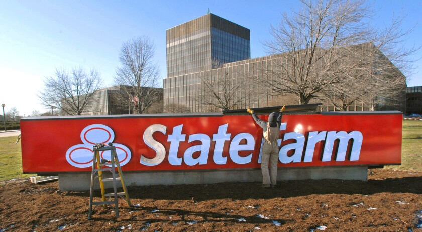 """State Farm is cutting 890 information technology positions in Bloomington as part of a """"realignment."""""""