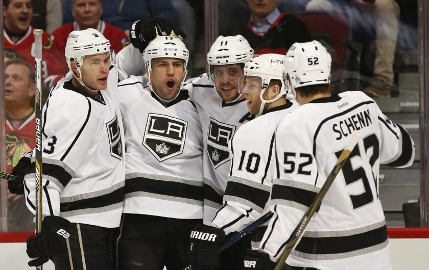 Kings left wing Milan Lucic, second left, celebrates with teammates after scoring a goal aginast the Blackhawks in the first period.