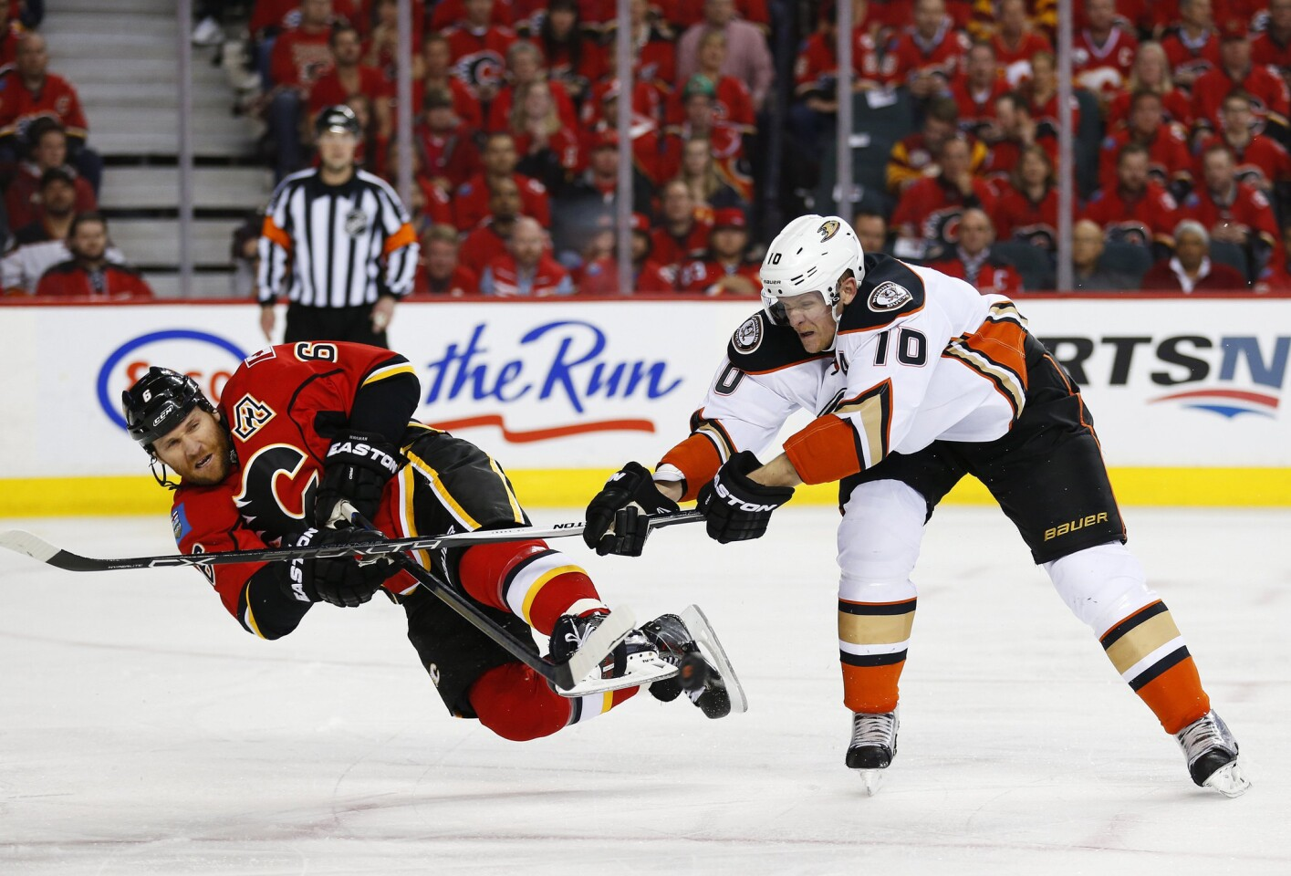 Calgary Flames' Dennis Wideman is sent flying by the Ducks' Corey Perry during Game 4 of their NHL playoff series Friday.