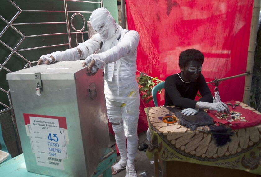 """Indonesian election officials dressed up as horror characters Wednesday to attract voters in the eastern Java city of Surabaya and deliver a message to elected leader to clean the """"evils"""" in government."""