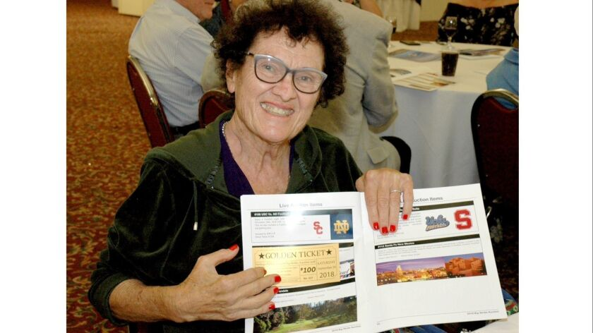 Boy Scouts Unit Commissioner Harriet Hammons displays her Golden Ticket that earned her entry to the