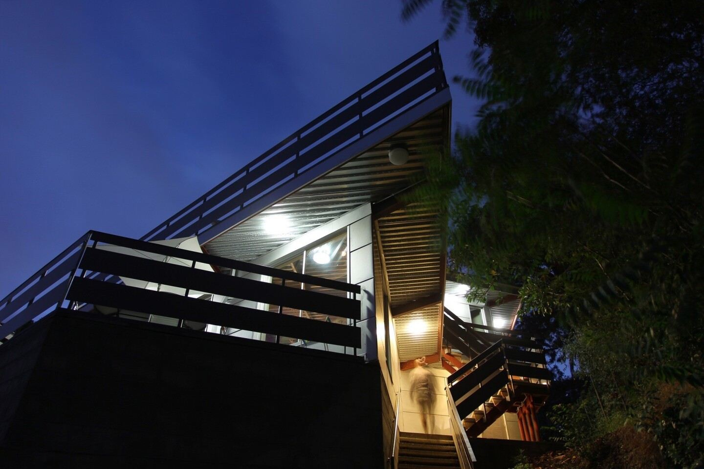 Stairs climb from the street toward the front door of the Tattuplex, Tim Tattu's Silver Lake house. The two-story house's unusual angles are built on a prefabricated steel system.