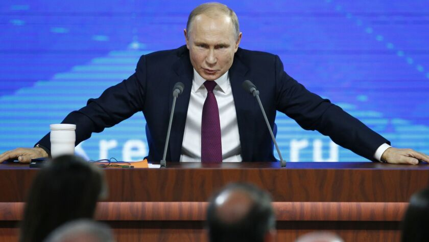 Russian President Vladimir speaks during his annual news conference in Moscow, Russia, Thursday, Dec