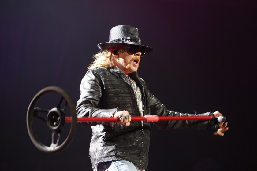 "Guns N' Roses lead singer Axl Rose performs in Seattle in 2011. His band will headline Coachella in April, but you won't hear about it on ""Jimmy Kimmel Live"" on Tuesday. He's no longer scheduled to appear."