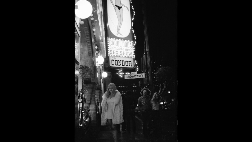 Carol Doda poses under a marquee bearing her name and likeness outside the Condor Club in the 1970s. She became a cocktail waitress at 14.