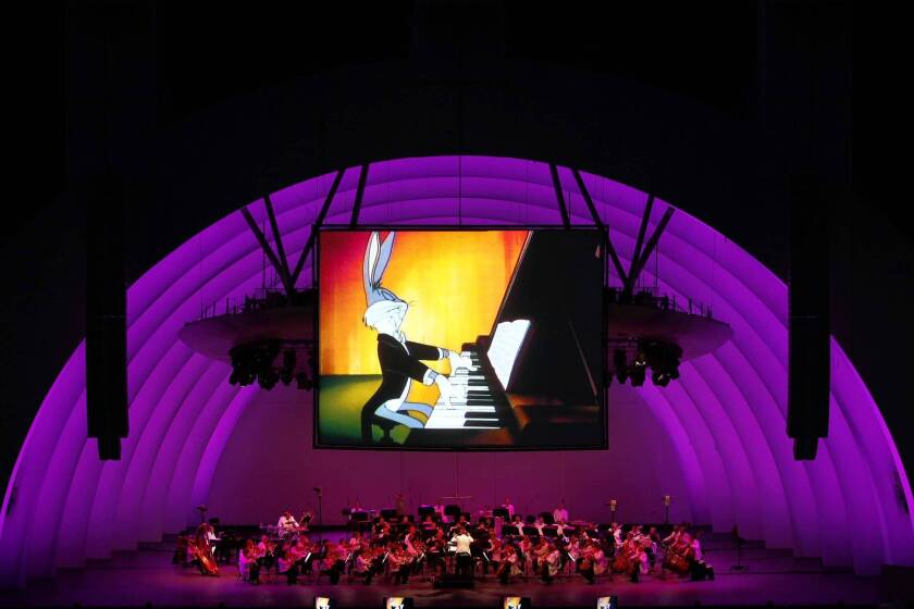 """The Los Angeles Philharmonic, conducted by George Daugherty, performs along with projections of Bugs Bunny, during """"Bugs Bunny at the Symphony II"""" at the Hollywood Bowl on July 5, 2013."""