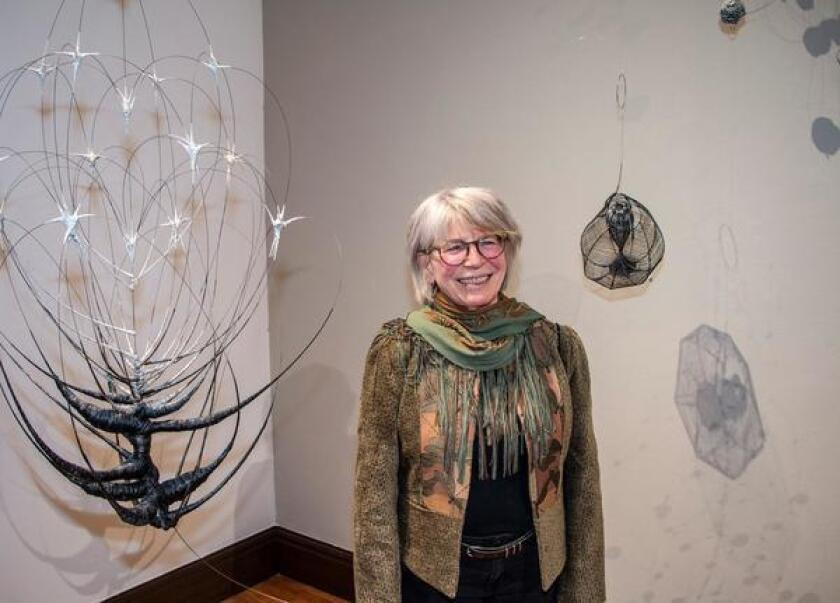 Anne Mudge with some of her wire sculptures