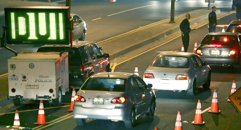 Cars line up at a DUI checkpoint on Los Feliz Boulevard at San Fernando Road in Glendale.