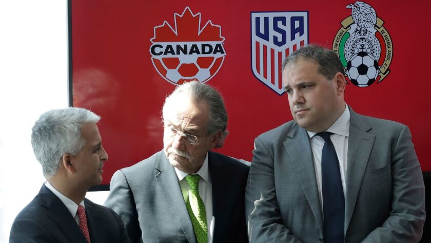 Sunil Gulati, left, President of the United States Soccer Federation, Decio de Maria, center, President of the Mexican Football Federation, and Victor Montagliani, President of the Canadian Soccer Association, hold a news conference on April 10 in New York
