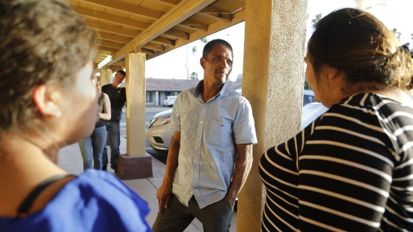 Calexico, CA_4_9_19_|Redin Antonio Bardales, center, a Honduran migrant and parent met up with two o