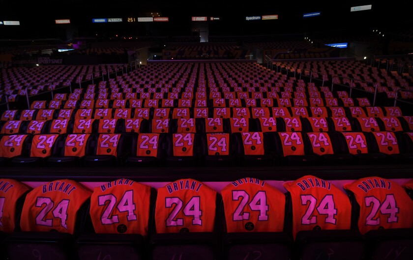 Kobe Bryant T-shirt jerseys cover seats at Staples Center before Friday's game between the Lakers and Portland Trail Blazers.