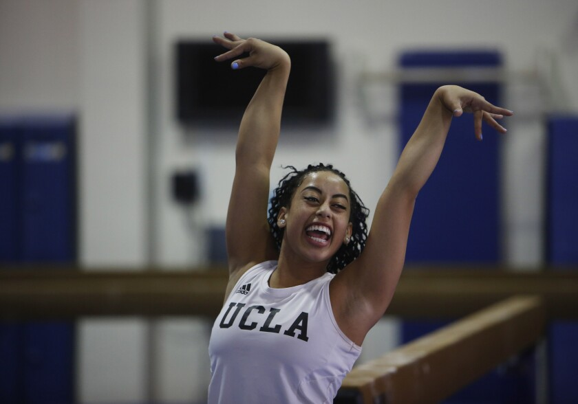 UCLA gymnast Sophina DeJesus finishes a floor exercise move with a flourish and a smile during practice this week. Internet video of DeJesus' floor routine at a meet over the weekend went viral.