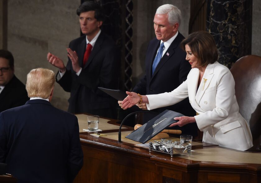 Speaker of the US House of Representatives Nancy Pelosi extends a hand to US president Donald Trump ahead of the State of the Union address at the US Capitol in Washington, DC, on February 4, 2020. (Photo by Olivier DOULIERY / AFP) (Photo by OLIVIER DOULIERY/AFP via Getty Images) ** OUTS - ELSENT, FPG, CM - OUTS * NM, PH, VA if sourced by CT, LA or MoD **