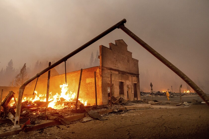 A fire burns next to a destroyed building in Greenville