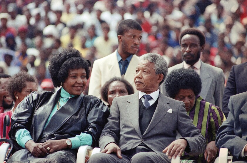 FILE - In this Feb. 13, 1990 file photo, Winnie Mandela, left, with her former husband Nelson Mandel